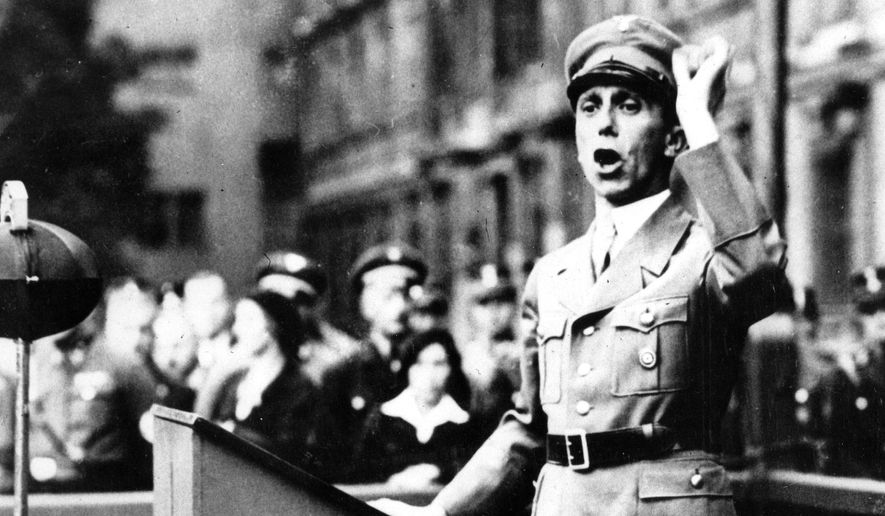 Dr. Joseph Goebbels, German minister of propaganda, addresses the 28th Brigade of Storm Troopers in the Lustgarten, Berlin on Aug. 26, 1934, before the demonstration at Coblenz. (AP Photo) ** FILE **