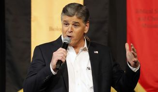 Fox News Channel's Sean Hannity speaks during a campaign rally for Republican presidential candidate, Sen. Ted Cruz, R-Texas, Friday, March 18, 2016, in Phoenix. (AP Photo/Rick Scuteri)