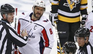 Washington Capitals' Alex Ovechkin (8) and Pittsburgh Penguins' Kris Letang (58) re separated by officials during the second period in Game 4 of an NHL second-round hockey playoff series in Pittsburgh, Thursday, May 3, 2018. The Penguins won 3-1. (AP Photo/Gene J. Puskar)