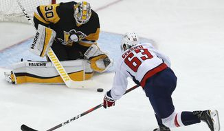 Pittsburgh Penguins goaltender Matt Murray (30) stops Washington Capitals' Shane Gersich (63) on a breakaway during the first period in Game 4 of an NHL second-round hockey playoff series in Pittsburgh, Thursday, May 3, 2018. (AP Photo/Gene J. Puskar) ** FILE **