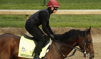Kentucky Derby entrant Mendelssohn runs during training at Churchill Downs Thursday, May 3, 2018, in Louisville, Ky. The 144th running of the Kentucky Derby is scheduled for Saturday, May 5. (AP Photo/Charlie Riedel)