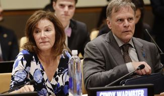 Fred Warmbier, right, and Cindy Warmbier, parents of Otto Warmbier, an American who died last year, days after his release from captivity in North Korea, wait for a meeting Thursday, May 3, 2018, at the United Nations headquarters. (AP Photo/Frank Franklin II)