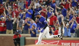 Fans stand and cheer as Texas Rangers' Nomar Mazara rounds first after hitting a three-run home run off Boston Red Sox relief pitcher Hector Velazquez during the fourth inning of a baseball game in Arlington, Texas, Thursday, May 3, 2018. (AP Photo/Richard Rodriguez)