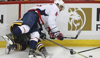 Washington Capitals' Alex Ovechkin (8) collides with Pittsburgh Penguins' Brian Dumoulin during the first period in Game 4 of an NHL second-round hockey playoff series in Pittsburgh, Thursday, May 3, 2018. (AP Photo/Gene J. Puskar)