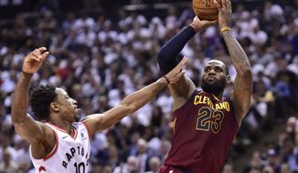 Cleveland Cavaliers forward LeBron James (23) shoots over Toronto Raptors guard DeMar DeRozan (10) during the second half of Game 2 of an NBA basketball playoffs second-round series Thursday, May 3, 2018, in Toronto. (Frank Gunn/The Canadian Press via AP)