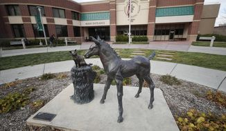 FILE - In this Nov. 6, 2017 file, photo, a sculpture stands outside the front door of the veterinary school at Colorado State University in Fort Collins, Colo. The mother of two Native American teenagers who campus police pulled from a Colorado State University campus tour after a parent reported feeling nervous about them said she believes her sons were victims of racial profiling and she feared for their safety after learning about the encounter.  (AP Photo/David Zalubowski, File)
