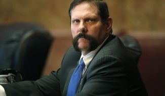 FILE - In this April 2, 2018, file photo, Colorado State Sen. Randy Baumgardner, R-Hot Sulphur Springs, looks on during a debate on the chamber's floor at the state Capitol in Denver. Baumgardner has been stripped of his committee assignments following new allegations of sexual and workplace harassment. (AP Photo/David Zalubowski, file)