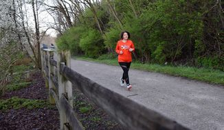 In this April 26, 2018 photo, Nicole Klan runs on the Montour Trail in Canonsburg, Pa. Klan lost 92 pounds and ran a half-marathon.  (Celeste Van Kirk /Observer-Reporter via AP)