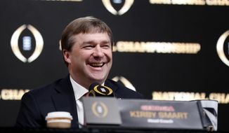 FILE - In this Jan. 7, 2018, file photo, Georgia head coach Kirby Smart speaks during a press conference ahead of the NCAA college football national championship in Atlanta. After leading Georgia to the national championship game, football coach Kirby Smart has been rewarded with a seven-year contract worth $49 million. Georgia's athletic association approved the contract extension and new compensation package Thursday, May 3, 2018. (AP Photo/David Goldman, File)
