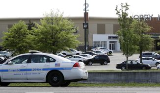 A police car sits outside Opry Mills mall Thursday, May 3, 2018, in Nashville, Tenn. Nashville police said a suspect was taken into custody after a person was shot inside the mall. The mall was evacuated after the gunfire was reported. One person was taken to a hospital and was reported to be in critical condition. (AP Photo/Mark Humphrey)