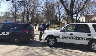 This photo provided by KVLY-TV/Fargo show authorities at the scene in Grand Forks, N.D., Thursday, May 3, 2018, after a police officer making a welfare check found four people, three elementary school children and a parent, dead inside a home. Administrators at Lewis and Clark Elementary School asked for the check on the home on the city's south side. (Ryan Laughlin/KVLY-TV/Fargo via AP)