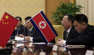 North Korean Foreign Minister Ri Yong Ho, second right, meets with Chinese Foreign MinisterWang Yi at the Mansudae Assembly Hall in Pyongyang, North Korea Wednesday, May 2, 2018. (AP Photo/Jon Chol Jin)