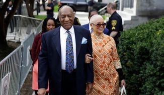 In this April 24, 2018, file photo, Bill Cosby, left, arrives with his wife, Camille, for his sexual assault trial at the Montgomery County Courthouse in Norristown, Pa. On Thursday, April 26, 2018, Cosby was convicted of drugging and molesting a woman in the first big celebrity trial of the #MeToo era, completing the spectacular late-life downfall of a comedian who broke racial barriers in Hollywood on his way to TV superstardom as America's Dad. (AP Photo/Matt Slocum, File)