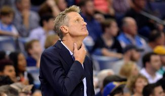 Golden State Warriors coach Steve Kerr stands on the sideline during the first half of the team's NBA basketball game against the Memphis Grizzlies in Memphis, Tennessee, Oct. 21, 2017. (AP Photo/Brandon Dill) ** FILE **