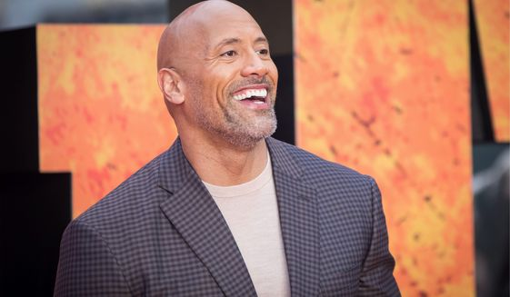 Actor Dwayne Johnson poses for photographers upon arrival at the premiere of the film 'Rampage', in London, Wednesday, Apr. 11, 2018. (Photo by Vianney Le Caer/Invision/AP)