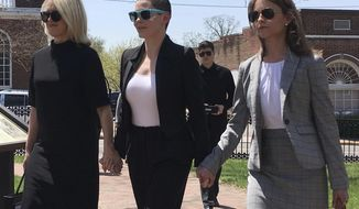 Actress Rose McGowan, flanked by lawyers Jennifer Robinson, left, and Jessica Carmichael, right, outside the Loudoun County courthouse Thursday, May 3, 2018, in Leesburg, Va. A judge is scheduled to hear evidence on whether a drug possession charge in Virginia against McGowan should go forward. (AP Photo/Matthew Barakat)
