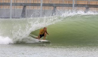 In this September 2017 photo provided by World Surf League, eleven-time World Champion Kelly Slater rides a wave at the Future Classic surfing meet in Lemoore, Calif. Slater has not only found what could be the perfect wave, but he's created it. Slater will introduce his Surf Ranch in Lemoore to the world this weekend, when the two-day Founders' Cup of Surfing is held on May 5 and 6, 2018, in a nondescript corner of California's Central Valley, some 100 miles from the Pacific Ocean. (Kenneth Morris/World Surf League via AP)
