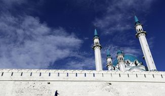 FILE - In this Friday, June 23, 2017 filer, Aaman walks in front of the Qolsharif Mosque, at the 16th century Kremlin, or citadel, one of UNESCO's world heritage sites in Kazan, Russia. (AP Photo/Thanassis Stavrakis)