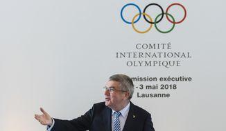 International Olympic Committee, IOC, President Thomas Bach from Germany, reacts prior to the opening of the International Olympic Committee, IOC, executive board meeting, in Lausanne, Switzerland, Wednesday, May 2, 2018. (Jean-Christophe Bott/KEYSTONE via AP)