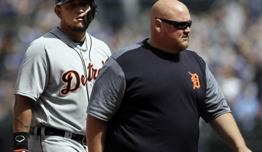 Detroit Tigers designated hitter Miguel Cabrera, left,  leaves with injury during the sixth inning of a baseball game against the Kansas City Royals at Kauffman Stadium in Kansas City, Mo., Thursday, May 3, 2018. (AP Photo/Orlin Wagner)