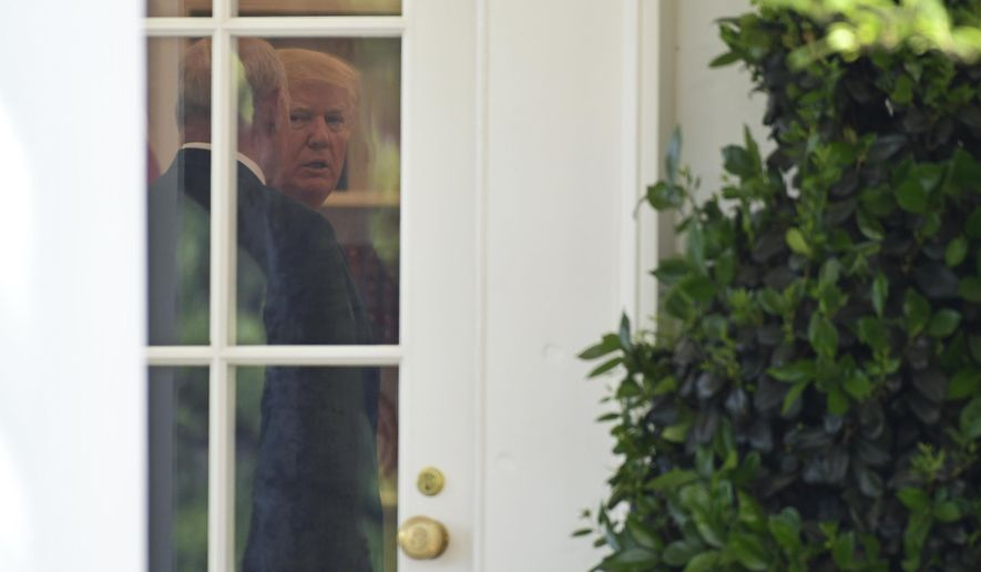 """President Donald Trump talks with White House Chief of Staff John Kelly in the Oval Office before the start of a National Day of Prayer event in the Rose Garden of the White House in Washington, Thursday, May 3, 2018. Rudy Giuliani, an attorney for Trump, says the president didn't know the full details of his personal lawyer's arrangement with a porn actress until """"maybe 10 days ago."""" Giuliani, appeared on """"Fox and Friends."""" He says that Michael Cohen was reimbursed for making a $130,000 hush payment to Stormy Daniels in the days before the 2016 election to silence her allegations of a sexual encounter with Trump.(AP Photo/Susan Walsh)"""