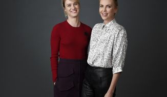"In this April 17, 2018 photo, Charlize Theron, right, and Mackenzie Davis, cast members in the film ""Tully,"" pose together  at the Four Seasons Hotel in Los Angeles. Theron portrays a mother of three and Davis portrays her night nanny. (Photo by Chris Pizzello/Invision/AP)"