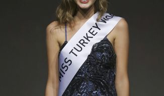 """FILE - In this Thursday, Sept. 21, 2017 file photo, Itir Esen, 18, smiles after being crowned Miss Turkey 2017 in Istanbul. A court has acquitted on Thursday, May 3, 2018 the former beauty queen of charges of """"insulting"""" the victims of a failed 2016 coup over a Twitter posting that had caused uproar. Esen was stripped of her Miss Turkey 2017 title and was later charged with insulting a section of the public for the tweet she posted as the country held memorials marking the failed coup.  (AP Photo, File)"""