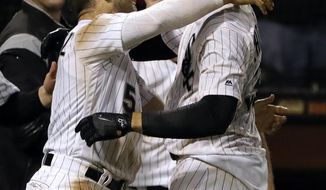 Chicago White Sox's Trayce Thompson, right, celebrates with Yolmer Sanchez after hitting a game-winning solo home run against the Minnesota Twins during a baseball game Thursday, May 3, 2018, in Chicago. The White Sox won 6-5. (AP Photo/Nam Y. Huh)