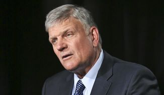"""In this May 1, 2018, photo, the Rev. Franklin Graham speaks during an interview about his latest book """"Through My Father's Eyes,"""" about his father the late evangelist Billy Graham in New York. Billy Graham's oldest son, Franklin, says his new book about his father is meant to share lessons he learned from the man known as """"America's Pastor."""" (AP Photo/Bebeto Matthews)"""