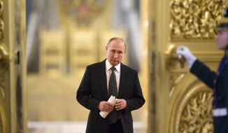 In this file photo taken on Thursday, April 5, 2018, Russian President Vladimir Putin enters a hall to chair a meeting of the State Council in the Kremlin in Moscow, Russia. If Putin fulfills the goals he's set for his new six-year term as president, Russia in 2024 will be far advanced in new technologies and artificial intelligence, many of its notoriously poor roads will be improved, and its people will be living significantly longer. (AP Photo/Alexander Zemlianichenko, Pool, File)