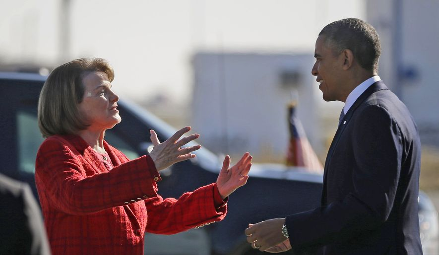In this Nov. 25, 2013, file photo, then-President Barack Obama and Sen. Dianne Feinstein, D-Calif., greet each other on the tarmac upon his arrival on Air Force One at San Francisco International Airport. (AP Photo/Pablo Martinez Monsivais, File)