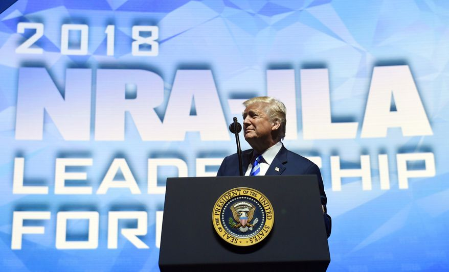 President Donald Trump speaks at the National Rifle Association's annual convention in Dallas, Friday, May 4, 2018. (AP Photo/Susan Walsh)