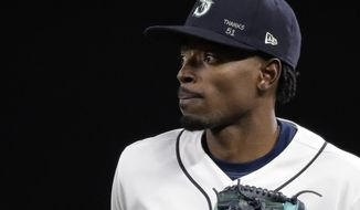 "Seattle Mariners center fielder Dee Gordon wears a cap with ""Thanks 51"" written on it in tribute to Mariners' Ichiro Suzuki as Gordon heads to the dugout during the seventh-inning stretch in the team's baseball game against the Oakland Athletics, Thursday, May 3, 2018, in Seattle. The Mariners announced Thursday that Suzuki would be transitioning to a front office role with the team and would not play the rest of the season. (AP Photo/Ted S. Warren)"