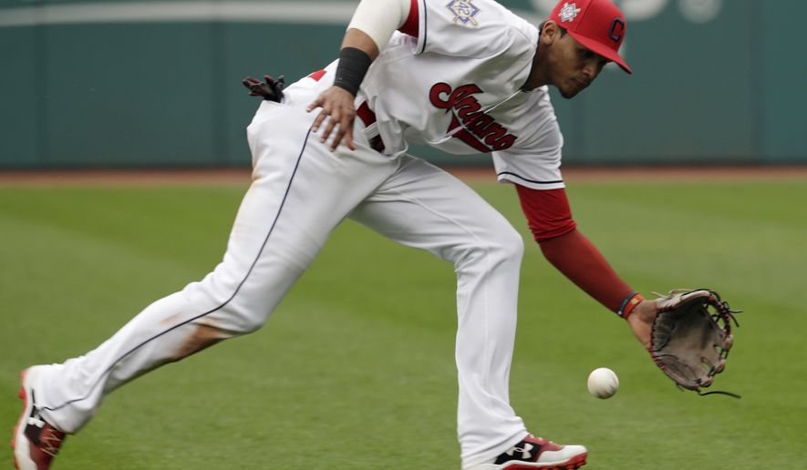 Cleveland Indians' Erik Gonzalez fields a ball hit by Toronto Blue Jays' Yangervis Solarte in the sixth inning in the first baseball game of a doubleheader, Thursday, May 3, 2018, in Cleveland. Solarte was out on the play. (AP Photo/Tony Dejak)