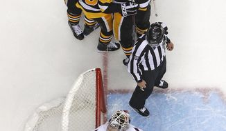 Pittsburgh Penguins' Jake Guentzel (59) celebrates after scoring while Washington Capitals goaltender Braden Holtby (70) collects himself during the second period in Game 4 of an NHL second-round hockey playoff series in Pittsburgh, Thursday, May 3, 2018. Guentzel had two goals in the Penguins' 3-1 win. (AP Photo/Gene J. Puskar)