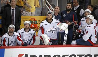 Washington Capitals goaltender Braden Holtby, center, stands with teammates as they look at the scoreboard to watch a replay of an empty-net goal by Pittsburgh Penguins' Jake Guentzel during the third period in Game 4 of an NHL second-round hockey playoff series in Pittsburgh, Thursday, May 3, 2018. The Penguins won 3-1. (AP Photo/Gene J. Puskar)
