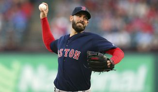 CORRECTS TO RICK PORCELLO, INSTEAD OF XANDER BOGAERTS - Boston Red Sox's Rick Porcello throws to a Texas Rangers during the first inning of a baseball game Friday May 4, 2018, in Arlington, Texas. (AP Photo/Richard W. Rodriguez)