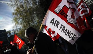 """FILE - In this Wednesday, April 11, 2018 file photo, Air France workers gather next to the company headquarters during a demonstration in Tremblay-en-France, outside Paris. French-Dutch company Air France-KLM's CEO Jean-Marc Janaillac has announced on Friday, May 4 his decision to resign amid an employee strike over pay. Janaillac said """"this is a huge waste that can only make our competitors rejoice"""" after Air France employees rejected a wage proposal. (AP Photo/Christophe Ena, file)"""