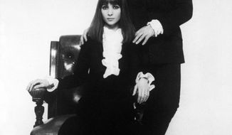 FILE - In this Feb. 22, 1968 file photo the Israeli folk-song couple, Esther and Abi Ofarim, who have rocketed into the British Pop Records Top Ten with their catchy song 'Cinderella Rockefella' pose for a photo in London. Abi Ofarim, who sang hit songs in the 60s with his wife in the musical duo Esther & Abi Ofarim, has died in Munich. He was 80.  (AP Photo)