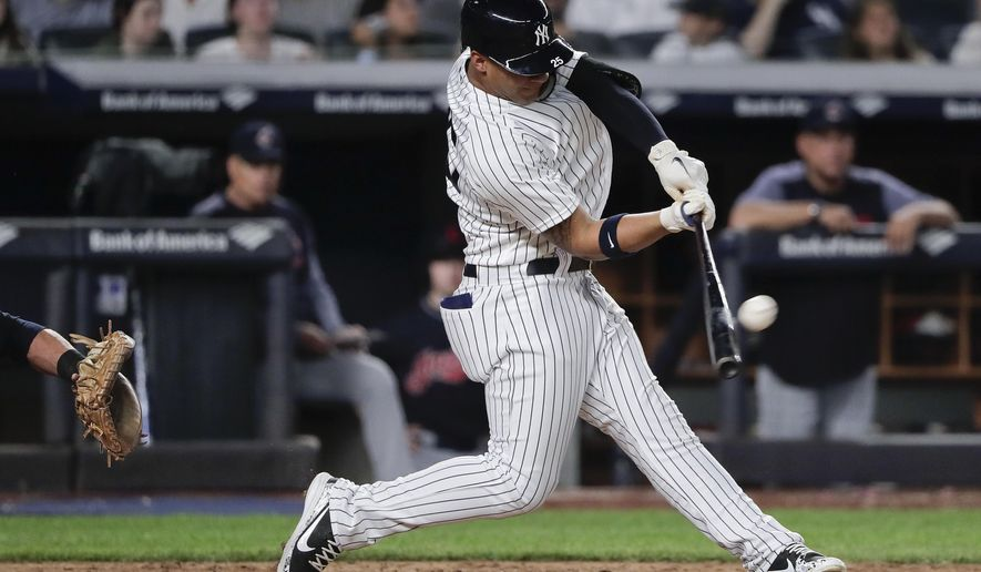 New York Yankees' Gleyber Torres connects for a three-run home run against the Cleveland Indians during the fourth inning of a baseball game Friday, May 4, 2018, in New York. (AP Photo/Julie Jacobson)