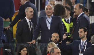 Roma club president James Pallotta, center, looks down from the stands during the Champions League semifinal second leg soccer match between Roma and Liverpool at the Olympic Stadium in Rome, Wednesday, May 2, 2018. (AP Photo/Alessandra Tarantino)