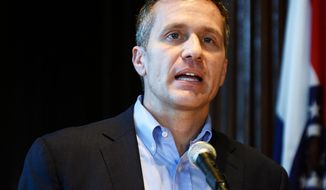 FILE - In this April 11, 2018, file photo, Missouri Gov. Eric Greitens speaks at a news conference in Jefferson City, Mo., about allegations related to his extramarital affair with his hairdresser.  Washington University says it's looking into whether grant money was misused after a former political aide for Greitens says he got paid from a grant to promote one of Greitens' books. University spokeswoman Julie Flory says the St. Louis-based school takes accountability seriously. She says the school is reviewing issues related to a Greitens' grant after the release this week of a House investigatory report. (Julie Smith /The Jefferson City News-Tribune via AP, File)