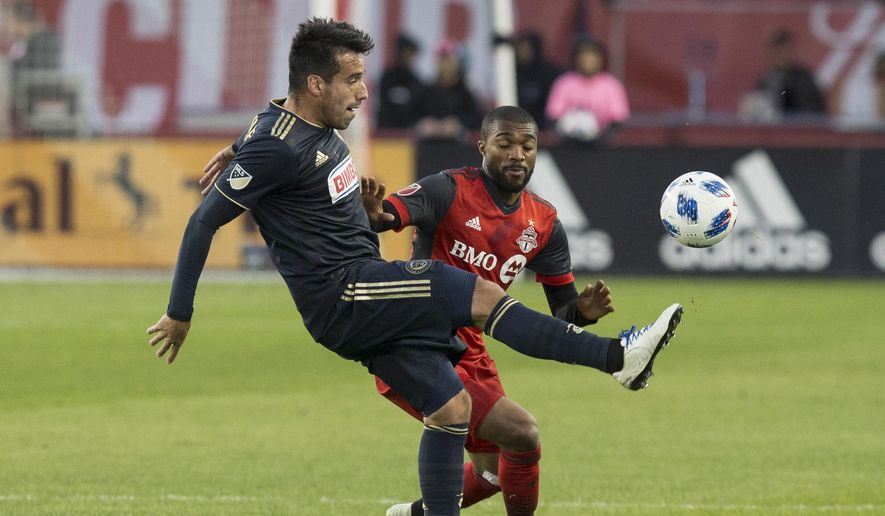 Philadelphia Union midfielder Alejandro Bedoya, left, works for the ball in front of Toronto FC defender Ashtone Morgan during the first half of an MLS soccer match Friday, May 4, 2018, in Toronto. (Chris Young/The Canadian Press via AP) **FILE**