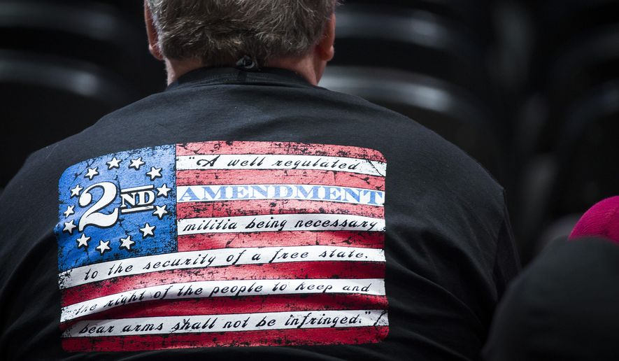 Members of the National Rifle Association who convened in Dallas last week turned their backs on accusations that the gun rights group was linked to Russian collusion in the 2016 presidential election. (Associated Press/File)