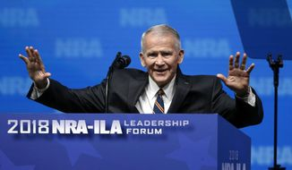 Former U.S. Marine Lt. Col. Oliver North acknowledges attendees as he gives the Invocation at the National Rifle Association-Institute for Legislative Action Leadership Forum in Dallas, Friday, May 4, 2018. (AP Photo/Sue Ogrocki)
