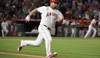 Los Angeles Angels' Albert Pujols runs to first on an RBI double during the second inning of the team's baseball game against the Baltimore Orioles Thursday, May 3, 2018, in Anaheim, Calif. The double marked his 2,999th career hit. (AP Photo/Mark J. Terrill)