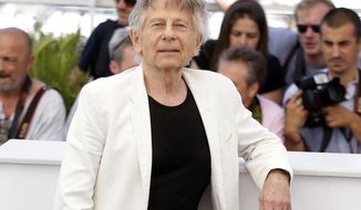 """FILE - In this May 27, 2017 file photo, director Roman Polanski poses for photographers during the photo call for the film """"Based On A True Story,"""" at the 70th international film festival, Cannes, southern France. Polanski has been a member of the film academy for 41 years since pleading guilty to unlawful sex with a minor in 1977, but that came to an end Thursday, May 3, 2018, when the organization behind the Oscars expelled both him and Bill Cosby from its ranks. (AP Photo/Alastair Grant, File)"""