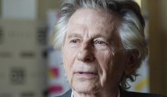 "In this May 2, 2018, photo director Roman Polanski appears at an international film festival, where he promoted his latest film, ""Based on a True Story,"" in Krakow, Poland. Polanski was expelled this week from membership in the Academy of Motion Picture Arts and Sciences, which organizers the Oscars, for unlawful sex with a minor 41 years ago. (AP Photo)"