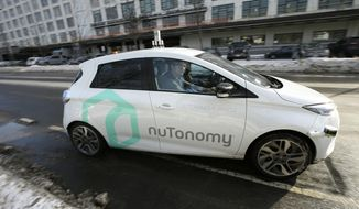 FILE - In this Tuesday, Jan. 10, 2017, file photo, an autonomous vehicle is driven by an engineer on a street in an industrial park in Boston. Harvard University's School of Public Health is holding a forum on Friday, May 4, 2018, to examine how recent deaths linked to self-driving technology are causing concern about safety, and raising questions about whether the field is moving too quickly. (AP Photo/Steven Senne, File)