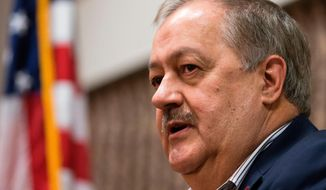 """FILE - In this Jan. 18, 2018, file photo, former Massey CEO and West Virginia Republican Senatorial candidate, Don Blankenship, speaks during a town hall to kick off his campaign in Logan, W. Va.  Blankenship has unleashed a political ad that takes swipes at """"China people"""" and calls the Senate majority leader """"Cocaine Mitch.""""  His ad says McConnell has created jobs for """"China people"""" and charges that his """"China family"""" has given him millions of dollars.McConnell's wife is U.S. Transportation Secretary Elaine Chao, whose parents are originally from China.(AP Photo/Steve Helber, File)"""